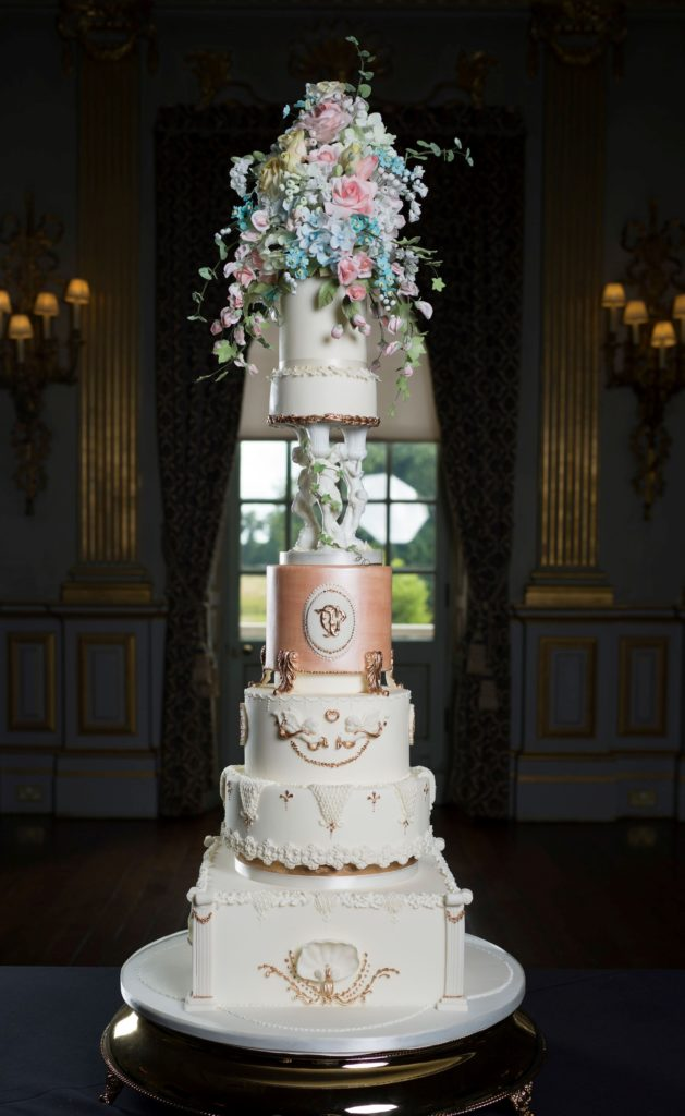 Photograph showing an elegant bespoke wedding cake in The Stucco Ballroom in Knowsley Hall