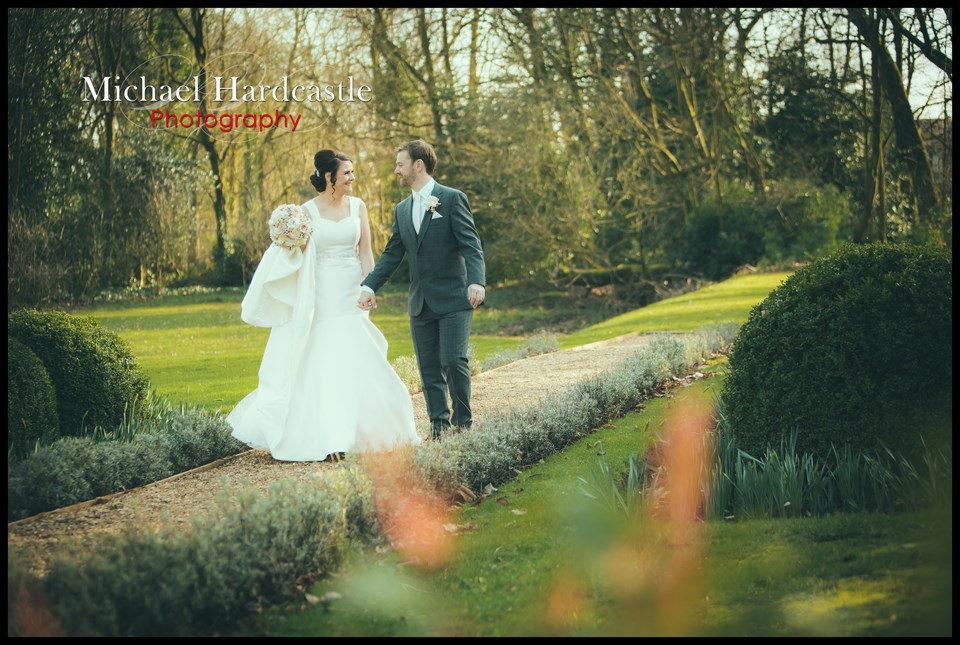 Bride and groom outside in gardens