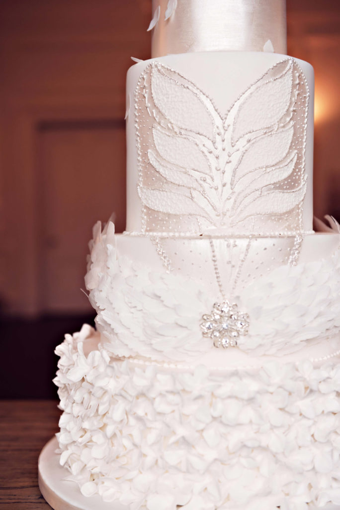 Photograph of handpiped royal icing tutu bodice and sugar feather headdress