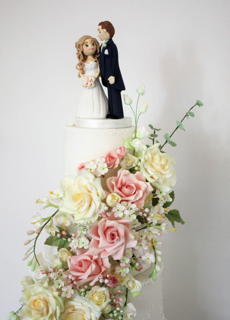 Sugar flower wedding cake with handmade couples topper