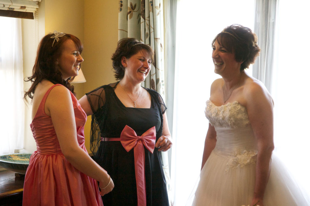 Bride-and-Bridesmaids-laughing-The-Cake-Pavilion.