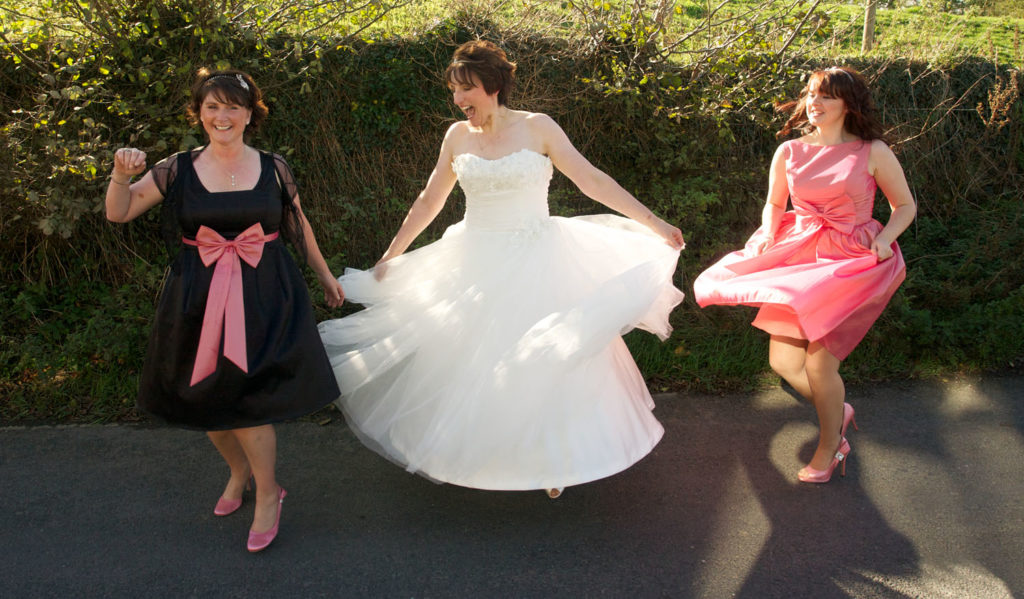 Bride and bridesmaids twirling