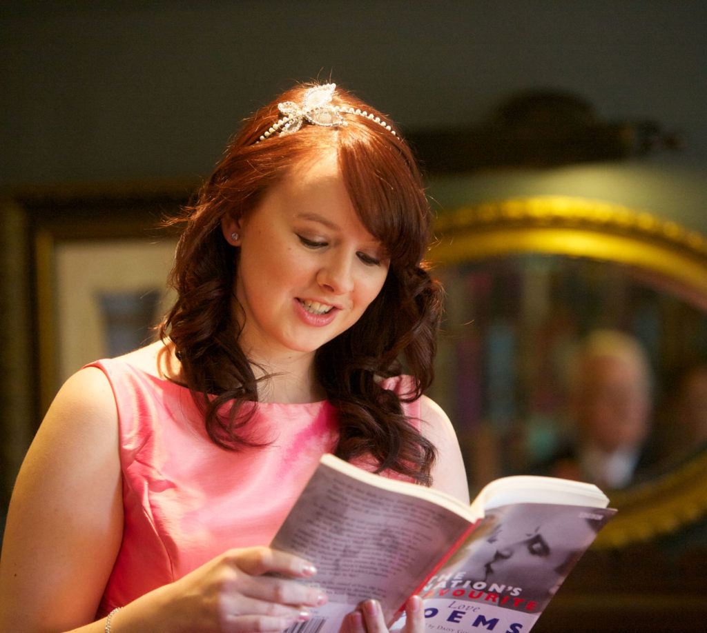 Bridesmaid doing a reading