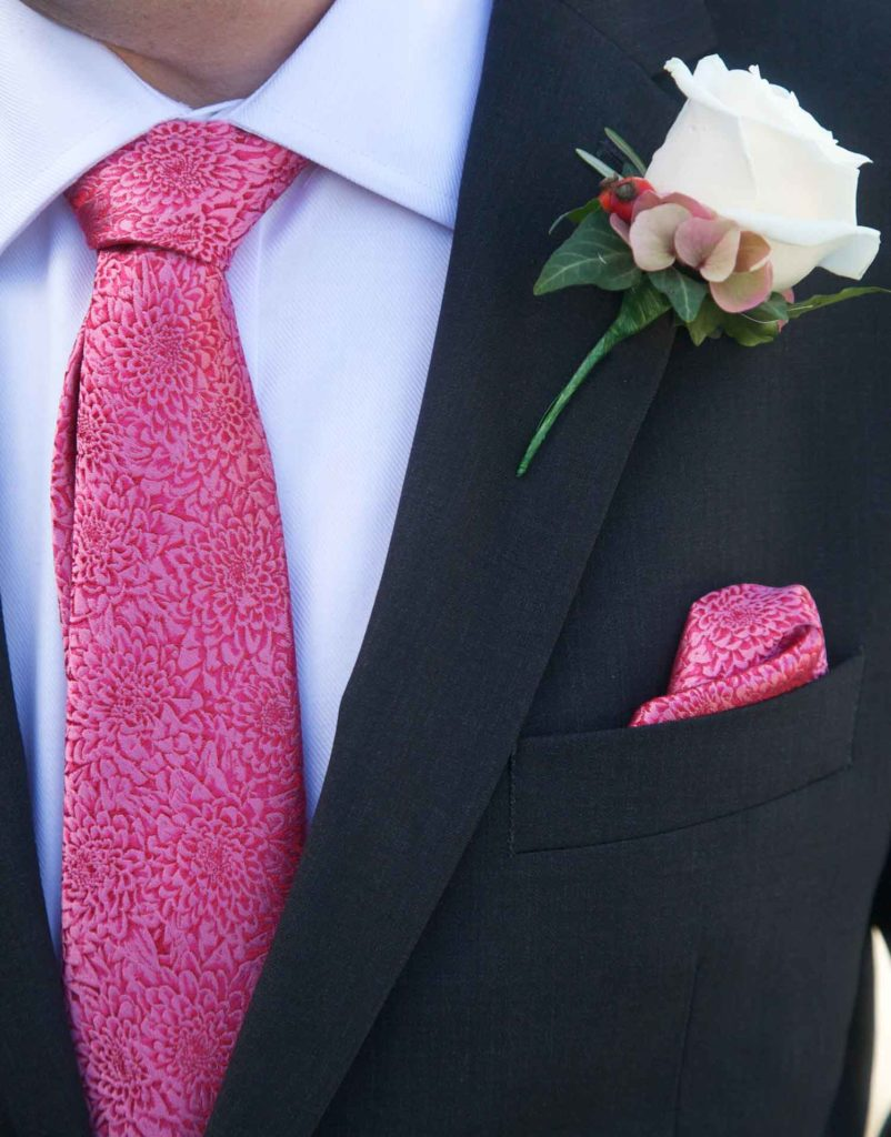 Grooms details tie handkerchief and buttonhole