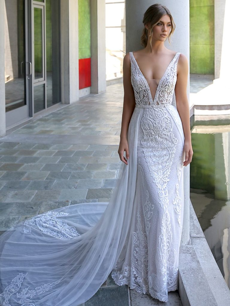 Bride in lace wedding dress with deep plunge neck line