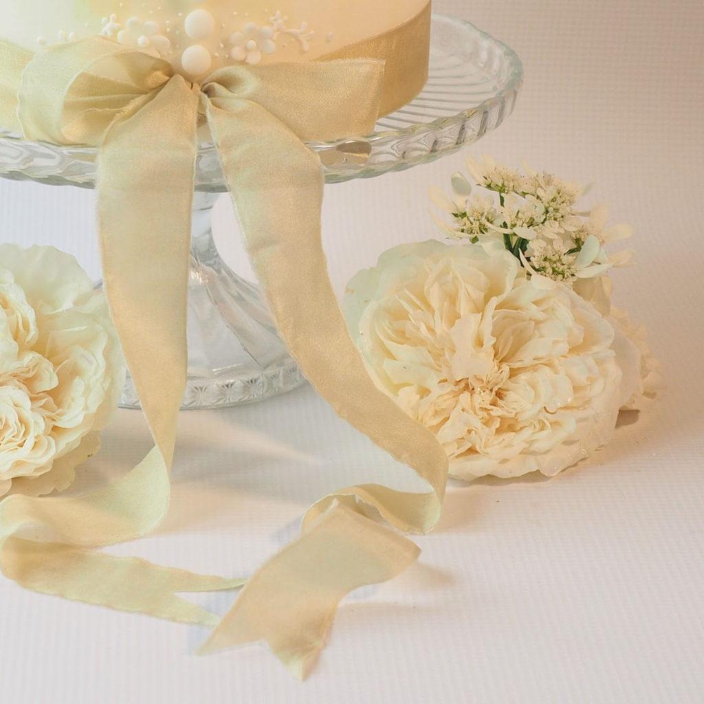 Beautiful silk ribbon trim on wedding cake