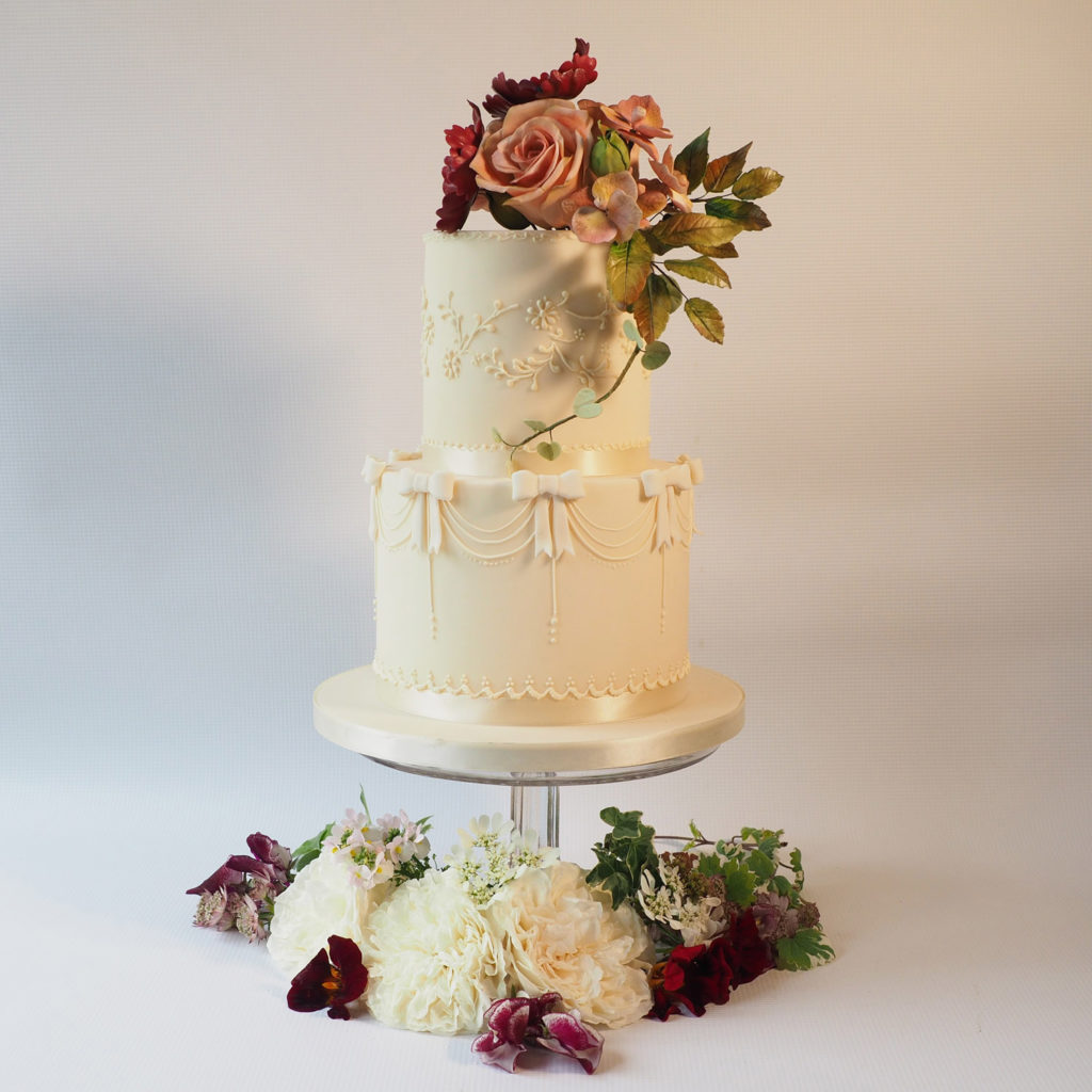 Two tier ivory wedding cake with sugar flowers