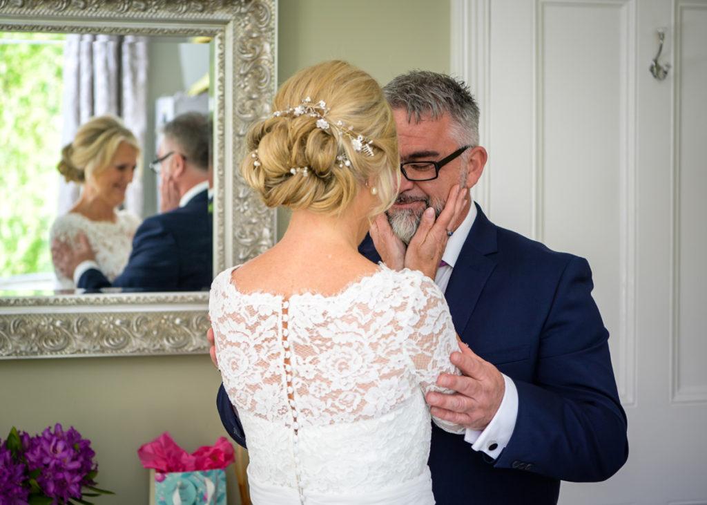 Bride and groom emotonal first look