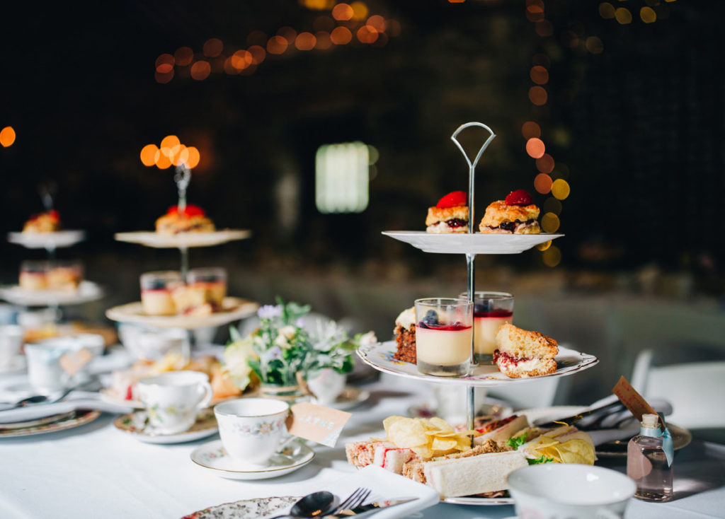 Afternoon tea with wedding favours of homemade candle vintage teacups