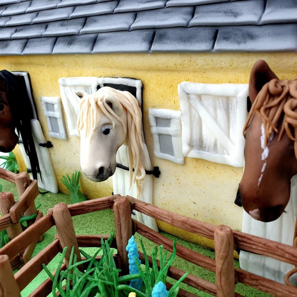 Hand made sugar horses in a stable