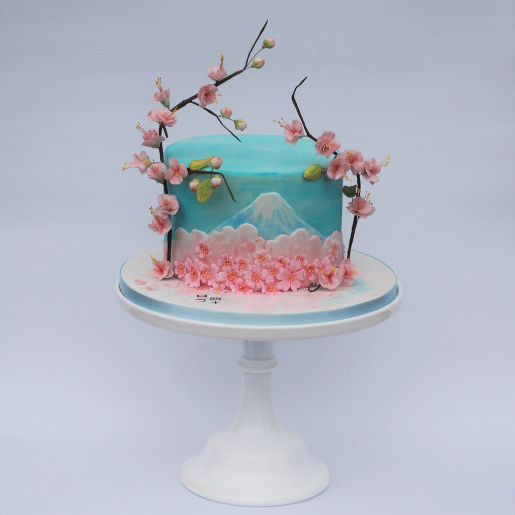 Japanese inspired cake with handpainted Mount Fugi nad sugar cherry blossom branches