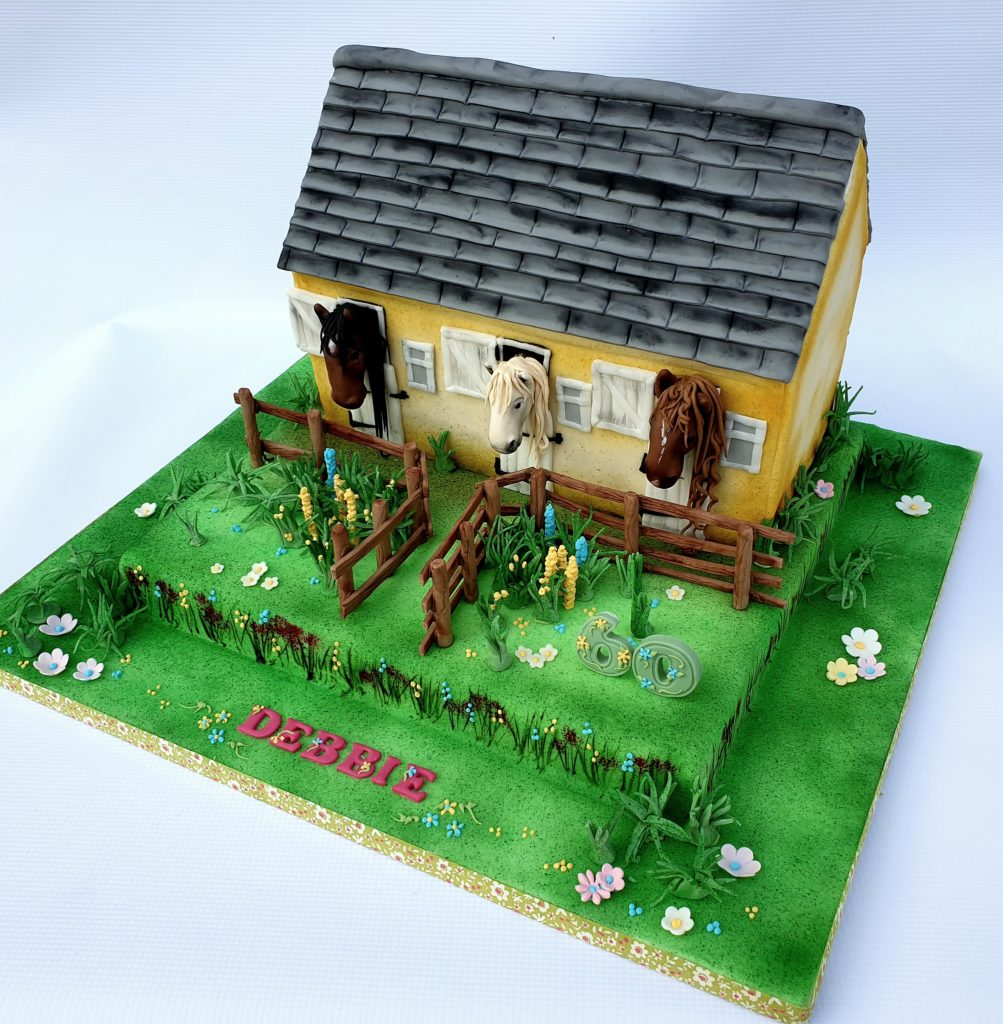 Carved Stable cake with gardens and sugar horses