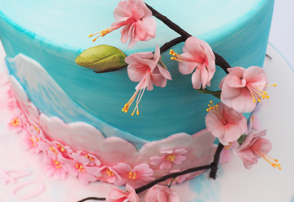 Sugar cherry blossom on a handpainted cake